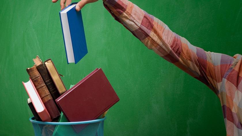 Man-throwing-away-books